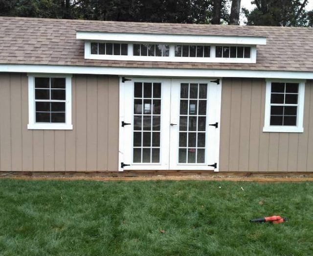 A Frame Outdoor Storage Shed with Grey T-111 Siding, Loft Windows, and Double Window
