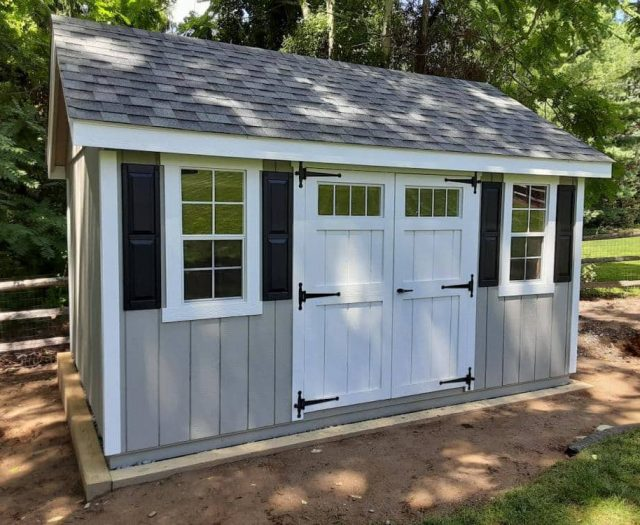 A Frame Shed with Grey T-111 Siding, White Double Doors, and Black Shutters