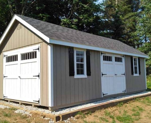 A-Frame Storage Shed with Grey T-111 Siding, White Trim, and Black Shutters