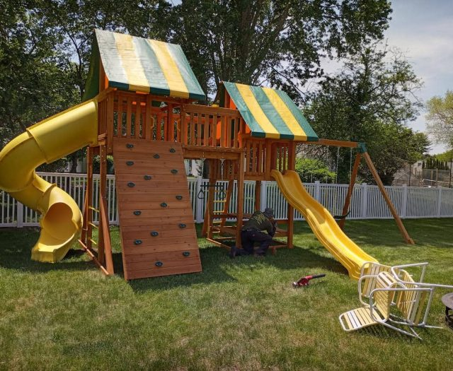 Fantasy Jungle Gym with Rock Wall, Yellow Spiral Tube Slide, and Bridge
