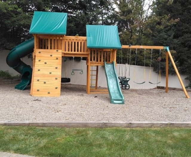 Fantasy Swing Set with Rock Wall, Horse Glider Swing, and Tire Swing