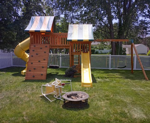 Fantasy Swing Set with Tire Swing, Yellow Wave Slide, and Double Cabin
