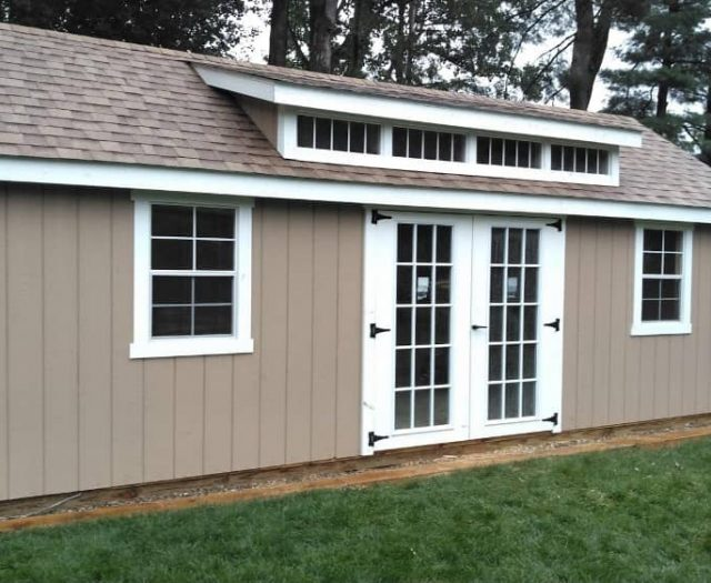 Giant A-Frame Shed with Dark Tan T-111 Siding, Windowed Double Doors, and White Trim