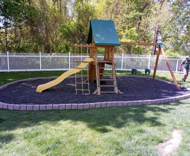 Supremescape Swingset with Greystone Border, Rubber Mulch, and Full Bucket Swings