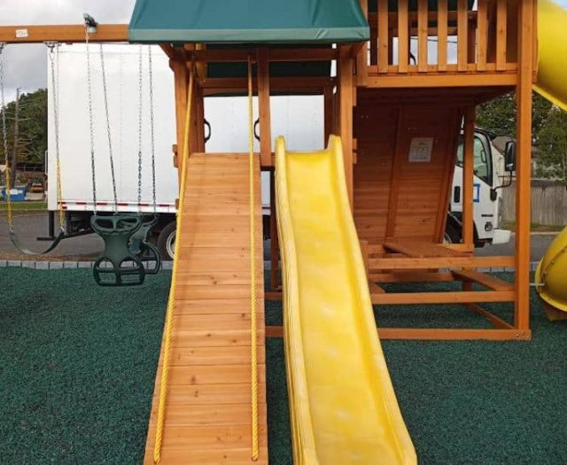 Sky Swing Set with Picnic Table, Yellow Wave Slide, and Green Tent Tops